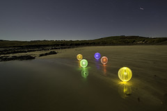 Beached (Colin Cameron ~ Photography ~) Tags: longexposure nightphotography blue red sea lightpainting green beach yellow night dark stars scotland colours purple surreal orb balls cliffs fullmoon moonlight glowing orbs isleoflewis stornoway lenser bayble lightjunkies baybleisland