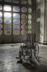 Alone in the dark (odin's_raven) Tags: longexposure light urban italy sunlight colour abandoned glass wheel photoshop hospital photography photo high italian chair nikon long exposure italia colours dynamic decay exploring explorer wheelchair stained photograph urbanexploration processing nikkor damaged asylum range destroyed hdr highdynamicrange decayed urbanexploring ue urbex photorealism postprocessing 2470mm abandonedhospital photomatix nikor odins abandonedasylum d700 talkurbex odinsraven