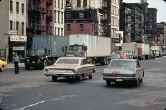 More New York fun from 1973!  A 1960s Ford Galaxie and a battered early 1960s Plymouth Valiant (fixed with bondo) cruise along Canal Street with peeling pavement. The Galaxie has a rope to lock the trunk. New York. (wavz13) Tags: vintage photography urbandecay oldphotographs oldphotos oldcars blight oldnewyork vintagecars instamatic vintagephotos beaters urbanblight oldphotography vintagephotographs vintagetrucks oldtrucks historicphotos historicphotography beatercars historicphotographs newyorkphotos vintagenewyork 1960scars 1970sphotos newyorkphotographs pocketinstamatic oldmanhattan 1970sphotographs 1950strucks vintagemanhattan 1970sphotography 1960strucks photoshistoric 1970snewyork 1970smanhattan photographshistoric oldnewyorkphotography oldnewyorkphotos