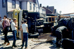 Overturned Truck Pittsburgh, PA c. 1969 (captainpandapants) Tags: street city house water truck puddle downtown pittsburgh boots accident pennsylvania places tires firetruck cobblestone pa fireman 1960s buildingtypes