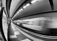 Coming Or Going (Sean Batten) Tags: uk england bw london train tube motionblur commuter passenger northernline claphamsouth