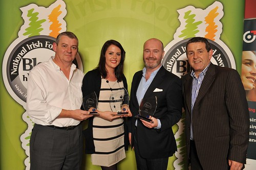 Una Martin of Una's pies with her 3 awards for her pies