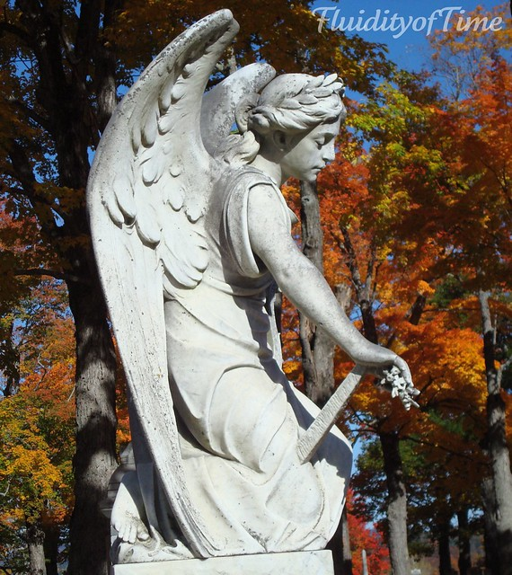 Maine, kneeling angel with sword