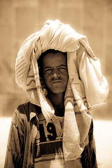 portrait of a little boy outside the St. Mary Zion Church in axum, tigray (anthony pappone photography) Tags: africa travel boy portrait blackandwhite blancoynegro barn digital canon pose religious photography photo blackwhite eyes foto child faces image expression retrato african picture culture porträt portraiture childrens afrika fotografia ethiopia crianças orthodox ritratto pilgrimage coptic pilgrim axum reportage photograher pilgrims afrique bambino eastafrica phototravel hosanna etiopia aksum abyssinia 非洲 ethiopie etiope アフリカ tigray afryka childrentravel etiopija portraitsofchildren tigrinya 아프리카 etiopien etiópia африка etiopi absoluteblackandwhite hosaina eos5dmarkii tigrini अफ्रीका childrenbestphotos christiancopticorthodox kililoch