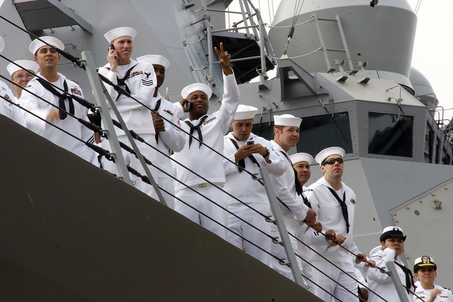 Sailors aboard USS Sruance are greeted by family and friends at Naval Base San Diego