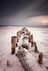 Wooden Supports (Martin..D) Tags: longexposure family sunset shells holiday seascape beach lines composition landscape denmark sand rocks silent wind stones dunes tripod filter northsea danish waters rotten dust posts filters depth leading piles blavand 2011 blvand canonef1740f4 canon5dmarkii wwwmartinsphotographycom bw1101000x