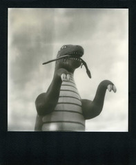 Dinosaur (Nick Leonard) Tags: winter arizona sky art film analog polaroid cool artwork dino dinosaur fierce snake teeth nick roadtrip scan paws creature holbrook claws polaroidsx70 instantfilm blackframe epson4490 polaroidsx70landcamera polaroidsx70sonar integralfilm nickleonard silvershade theimpossibleproject ndpackfilter px600 px600uv poorpodpack polaroidonestepsx70sonar