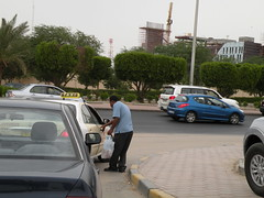 Getting a Taxi (Mink) Tags: life road street people man men cars garden highway market taxi centre 4th daily ring kuwait friday kuwaiti nurseries