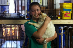 Gabby is glad her pet cat Alex is safe at the temporary shelter