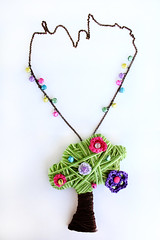 the sound of the tree (crayz*) Tags: flowers tree verde green bells necklace sound albero collana fiorellini campanellini