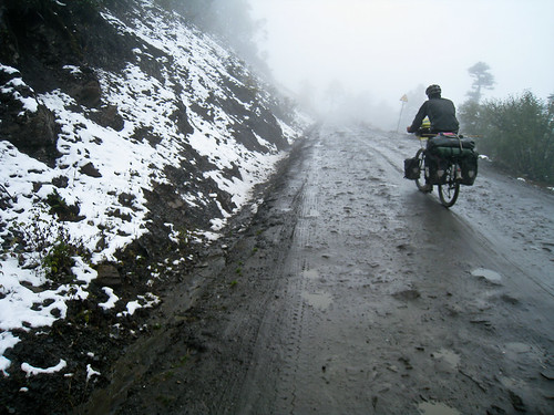 Justin cycling on bad road + snow