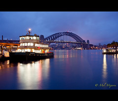 A glimpse of Sydney Harbour Bridge (Mel Mijares) Tags: bridge blue house canon golden harbor boat yahoo google twilight opera ship mel explore hour wikipedia qantas sydneyharbourbridge pedestrain