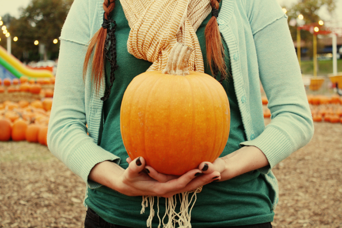 *take a photo with a pumpkin*