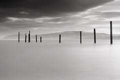 TEN (Anthony Owen-Jones) Tags: ocean uk longexposure sea blackandwhite bw cloud white seascape black mountains bird beach nature water monochrome wales clouds canon lens landscape eos rebel mono bay coast landscapes photo seaside kiss europe long exposure moody natural unitedkingdom jetty horizon north picture gimp naturallight minimal hills filter photograph ethereal nd kit postprocess minimalist bnw conwy t3i x5 rhosonsea colwynbay northwales rhos colwyn 600d takenwith 10stop nd110 canonefs1855mmf3556is rebelt3i kissx5
