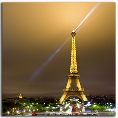 Eiffel Tower.....Paris, France. (M. Shaw) Tags: lighting longexposure paris france building history monument skyline architecture night clouds canon lights europe downtown cityscape eiffeltower historic lighttrails latour cloudynight 2470mmf28l mshaw 5dmark2 canoneos5dmarkll nightsbestimages