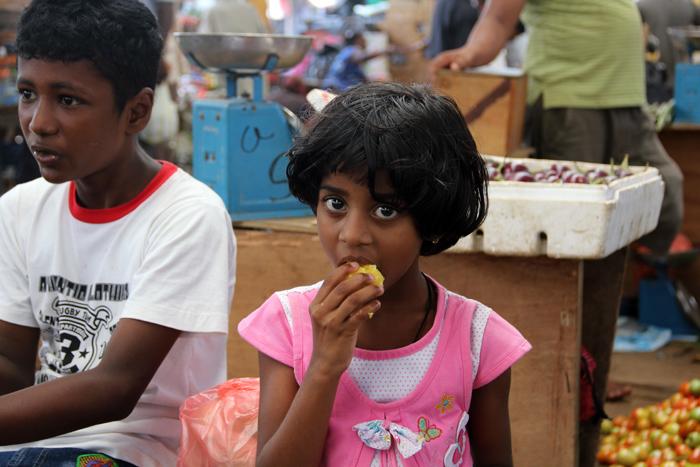 Girl Munching on a Mango, Colombo, Sri Lanka
