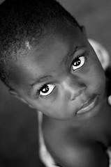 In A Childs Eye's (rmaspero) Tags: poverty africa portrait bw baby white money black reflection eye beautiful face mouth children kid eyes education child african orphan future stare uganda sponsor raise sponsorship