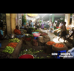 Street Life (SenShots / Senthilmani's Photography) Tags: morning red people woman sun man men green public fruits vegetables garbage market crowd group carrot buy shops onion waste sell chennai selling sellers buyers koyambedu senshots senthilmani