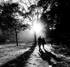 a walk in the park (Ian Brumpton) Tags: street england blackandwhite bw london blancoynegro monochrome blackwhite interestingness candid streetphotography streetlife monochromatic explore squareformat londres itsawonderfullife shadowplay frontpage contrejour biancoenero parklife shadowlands streetportraiture sidewalkstories explored londonstreetphotography reflectionsinagoldeneye flickriver scattidistrada neroametà livinginaheartshapedworld ianbrumpton aimlessstrolling sundaychilling londonatlarge