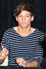 Louis Tomlinson One Direction attend a signing for their new album 'Up All night' at Tesco Extra Maynooth in Kildare Kildare, Ireland