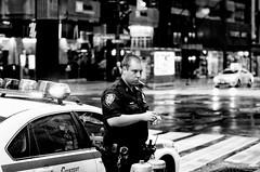 The Smoking Gun (Trovarsi) Tags: street blackandwhite newyork nikon gun police nypd smoking officer smokebreak d7000