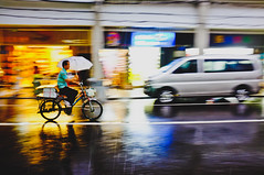Symphony of rain (A. adnan) Tags: guangzhou china street motion blur colors rain bicycle night cycle panning gettyimageschinaq3