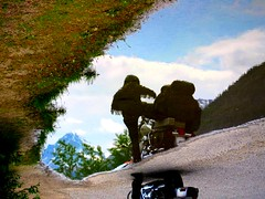 Flipped puddle reflection: A biker and his bike (peggyhr) Tags: blue trees friends sky brown white snow canada black mountains reflection green water clouds puddle helmet explore motorbike alberta grasses roadside shrub banffnationalpark motorcyclist fringedjacket leatheroutfit globalvillage2 peggyhr theunforgettablepictures theunforgettablepicture explorewinnersoftheworld flickrsbestpictures rainforestink 7255ap