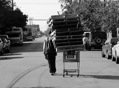 Working hard to make a buck, Chicago near west side. (Cragin Spring) Tags: city urban bw chicago man illinois midwest homeless shoppingcart chitown scene il westside pallets struggling chicagoillinois chicagoil recession