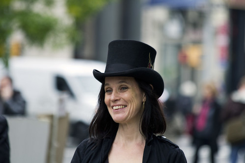 Lady with a top hat and a smile by Frank Fullard