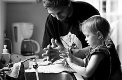 Learning process (Julius Le Petit) Tags: portrait bw white black canon 50mm kid noir lulu noiretblanc outdoor sigma enfant extrieur fille blanc xsi 450d