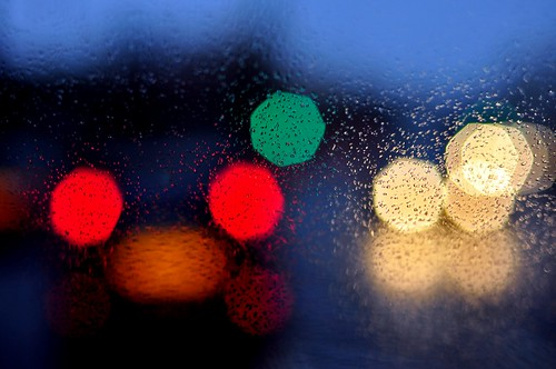 #10 traffic through a rain soaked window.