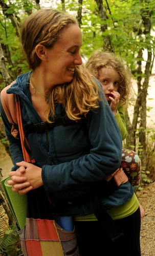 Riding piggyback, a shy girl and her mom, yogamat, colorful bag, forest, Breitenbush Hot Springs, Breitenbush, Marion County, Oregon, USA by Wonderlane