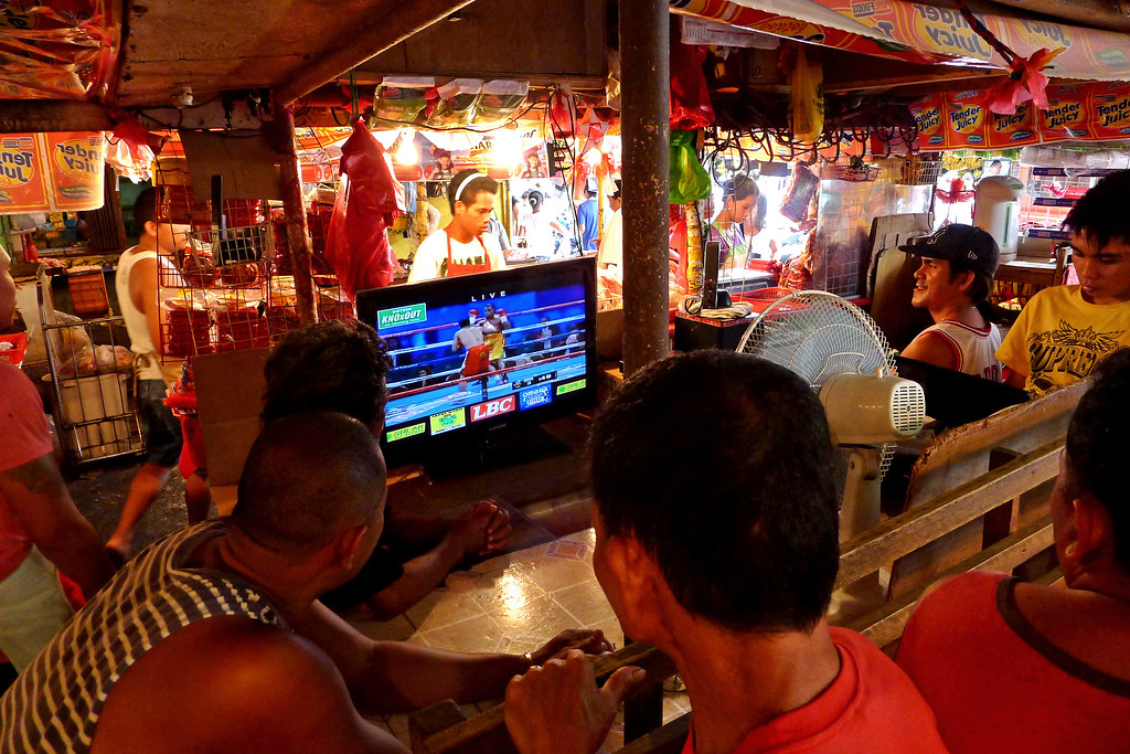 Meat vendors in Agdao Market, Davao City on Sunday, November 12 takes a break as they watch the undercard fights ahead of Pacquiao-Marquez fight by lunchtime.