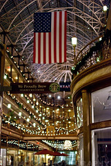 the arcade starbucks (.:Chelsea Dagger:.) Tags: christmas old ohio usa history architecture night america 35mm court mall photography lights hotel downtown unitedstates balcony flag cleveland arcade victorian skylight americanflag indoor clevelandohio nighttime american shops historical hyatt euclid stores brass regency richardsonian chelseadagger chelseakaliwhatever cmckeephotography chelseamckee
