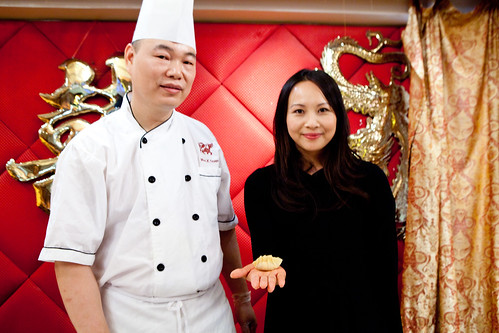Ching-He Huang holding her dumpling and the dim sum chef of Golden Unicorn