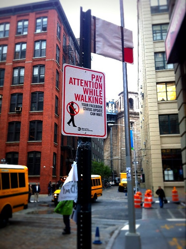 "Sign: ""Pay Attention While Walking"""