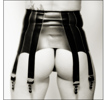 Woman wearing rubber girdle for erotica nudes photography.