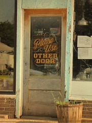 Please use other door (jimsawthat) Tags: reflection brick junk doors whitecity kansas antiques secondhand smalltown doorways paintonglass