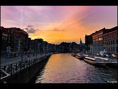 Colors of amsterdam (Kader Lagraa) Tags: travel light sunset sky people holland building water netherlands colors beautiful beauty amsterdam yellow clouds composition contrast photography boat canal photo amazing interesting nikon warm europe ship purple shot image feel picture scene western mm quite nikkor capture tones paysbas learn vr lense discover sense 1635 benelux kader abdelkader d700 lagraa klagraa