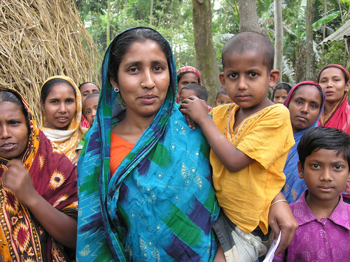 Women and children in a fishing village, Bangladesh. Photo by Peter Fredenburg, 2009