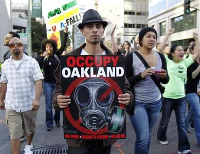 Thousands marched through Oakland, California as part of a general strike in response to police brutality against the Occupy Oakland movement. Scott Olsen, 24, was critically wounded by a cannister fired into a crowd by police. by Pan-African News Wire File Photos