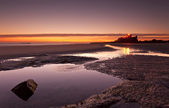 Bamburgh dawn (Steve Clasper) Tags: uk sunrise reflections dawn north northumberland northern bamburghcastle steveclasper