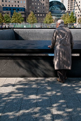 1018 Pic a Day 2011 -- Solitary Mourning (Laurie2123) Tags: fountain beautiful memorial sad 911 newyork newyorkcity nikond300 worldtradecenter 911memorial worldtradecentermemorial neverforget laurie2123 tamron1750mm
