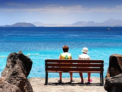 dreaming about blue - ( explored ) (mujepa) Tags: bench seascape blue dream banc paysage rest repos bleu tourists touristes character personnages playablanca lanzarote canaryislands canaries spain espagne artistoftheyearlevel2