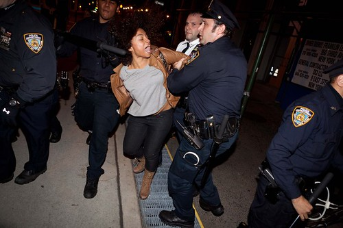 New York cops manhandle a woman at Zaccotti Park in the Wall Street district as the city of New York evicted hundreds from the park which was  hundreds of demonstrators. by Pan-African News Wire File Photos