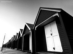 Distortion (Rafe Abrook Photography) Tags: green wideangle olympus isleofwight solent cowes beachhuts zuiko iow gurnard 918mm