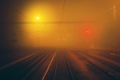 looking back (next_in_line) Tags: mist fog night train 35mm lights nikon rail f18 d5000