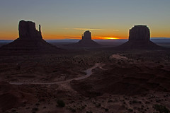 Light the Way (dbushue) Tags: road morning arizona sky sun southwest nature sunrise dark landscape dawn scenery rocks butte valley monumentvalley lightness mittens navajotribalpark 2011 coth supershot naturesgarden absolutelystunningscapes damniwishidtakenthat coth5 dailynaturetnc11