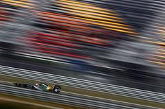 Jarno balsts past the grandstands in Korea 2011 (2011 Team Lotus photo archive) Tags: oct grand 11 f1 formulaone xxx formula1 gp kor mike prix on korean track korea 2011 riad kovalainen gascoyne 2011 t128 jarno trulli heikki asmat karun chandhok