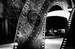 The Film Strip U.S.A. Fountain - Nikon FE - Nikkor-SC 55mm F/1.2 - TMAX 3200 (divewizard) Tags: california blackandwhite bw sculpture usa white black slr blancoynegro film blanco fountain branco analog 35mm blackwhite analgica nikon tmax3200 noir y noiretblanc kodak tmax negro preto 55mm strip e fe 3200 et blanc nikonfe culvercity f12 brancoepreto pelcula blackwhitephoto losangelescounty blackandwhitephoto veteransmemorialpark blackandwhitephotos schwarzundweiss blackwhitephotos y44 nikkorsc ncps chrisgrossman 55mmf12sc northcoastphotographicservices nikkorsc55mmf12 filmstripusa filmstripusafountain nikkorsc nikkorsc55mmf12 veteransmemorialauditorum veteransmemorialcomplex